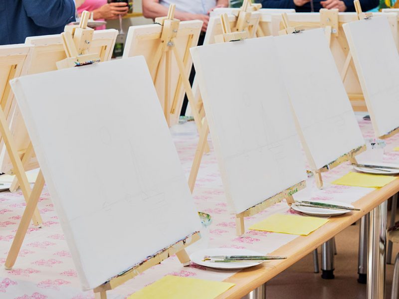 Canvases, brushes, palettes on the table ready for the art studio masterclass